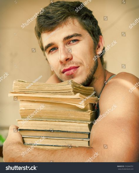 Portrait of a young male worker who looks athletic books #Ad , #Ad, #male#young#Portrait#books
