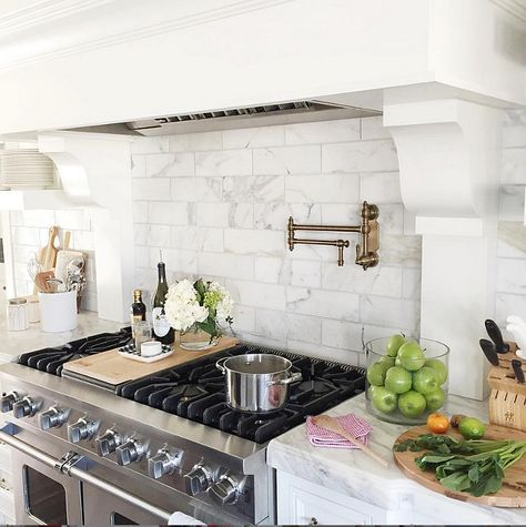 Kitchen Hood with marble tile backsplash. Pink Peonies.