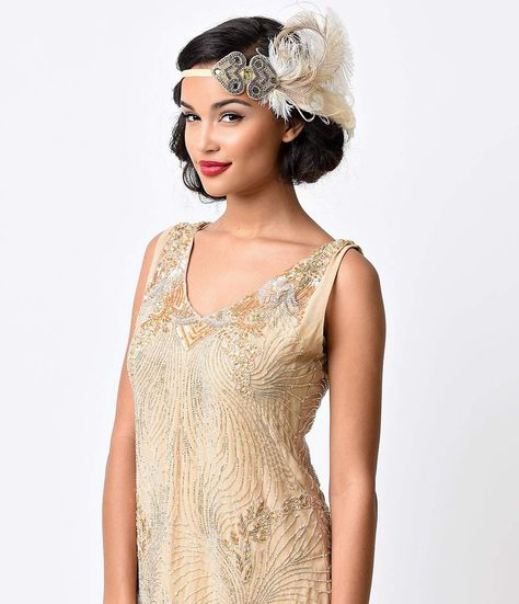 Modern nostalgia meets breathtaking design in this fabulous flapper headband, featuring a gorgeous burst of champagne peacock and white ostrich feathers complemented by stunning deco beaded design. The appliqu rests on a fine quality cream grosgrain velv