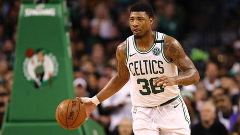 Marcus Smart 'was born with his hands dirty'  and he'll do anything