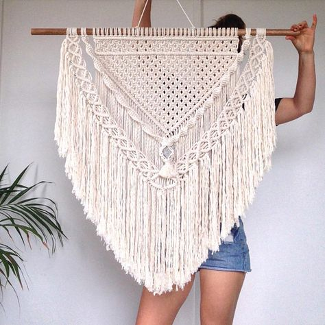 This gorgeous Jenny macrame is handmade with natural cotton rope. It features a grey stone centrepiece creating the perfect coastal vibe for any space! *Height- Top of timber to bottom of fringe approx 85cm * Width- From one end of timber to the other approx 90cm *Please know that