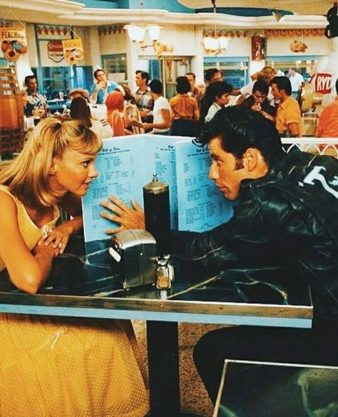 Olivia Newton-John as Sandy Olsson and John Travolta as Danny Zuko in Grease 70s Aesthetic, Aesthetic Movies, Couple Aesthetic, Aesthetic Collage, Aesthetic Vintage, Aesthetic Photo, Aesthetic Pictures, Bedroom Wall Collage, Photo Wall Collage