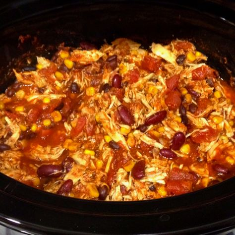 I am sure I pinned this before but I did not want to take a chance that I didn't!  Chicken taco chili...only about 200 calories a serving and made 8 servings! 1 can black beans, 1 can kidney beans, 1 can corn kernels, 16 oz tomato sauce, 28 oz diced tomatoes, packet taco seasoning, 1 tbsp chili powder, 3 boneless chicken breasts. 6 hours high or 10 hours low in the crock pot.