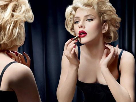 Buxom beauty Scarlett Johansson as Marilyn Monroe campaigns for Dolce and Gabbana in 2010.