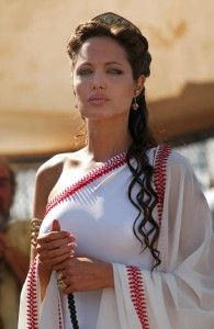 Angelina Jolie wearing a ancient greek inspired himation. Her hair is also curled as they would've in ancient crete and greece with a headdress