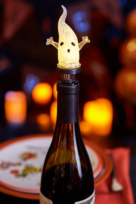 This spooky little LED Ghost Bottle Stopper from Pier 1 lights up to remind you of the dire consequences you could face if you don't let your wine breathe. Or perhaps you could employ this hand-painted glass spirit to guard your favorite bottle of spirits.