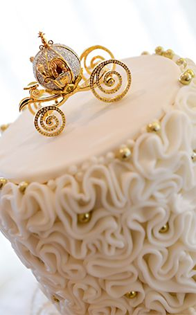 Top your wedding cake with Cinderella's golden carriage to create a perfect happily ever after masterpiece