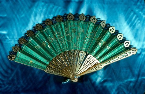Fan: ca. 1900, satin with lace edging.