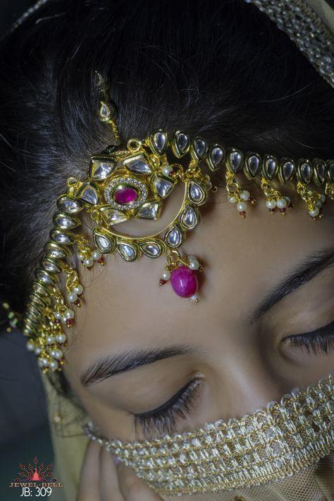 Kundan jewellery matha-patti with red pearls and premium quality.