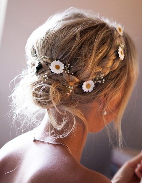 We love a beautiful bridal braid, add flowers and we're smitten! This year we are in love with delicate flowers intertwines in gorgeous braids.