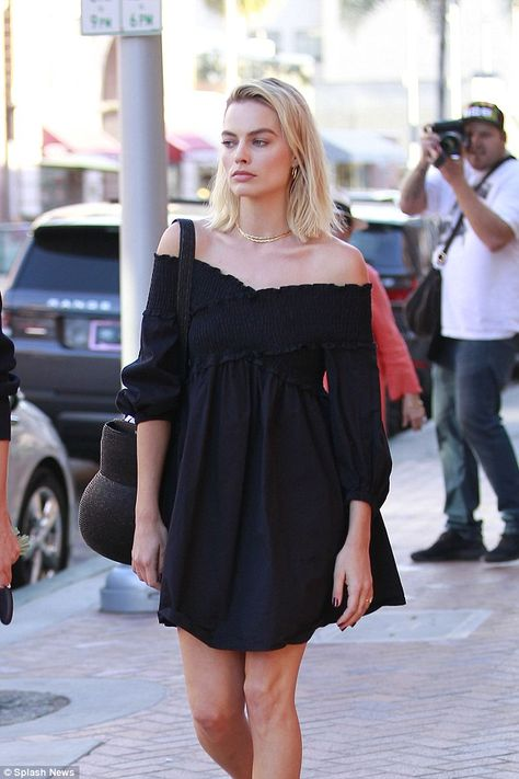 Simply stunning! Wearing her hair out in tousled waves Margot showed off her glowing complexion by wearing little to no makeup