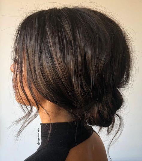 Voluminous Low Tousled Updo for Shorter Hair