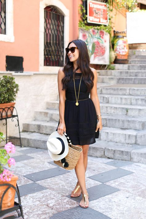 Kat Tanita of With Love From Kat wears a Sam Edelman little black summer dress with Sam Edelman Gigi sandals, a Kayu bag, and panama hat in Taormina Sicily. - Total Street Style Looks And Fashion Outfit Ideas