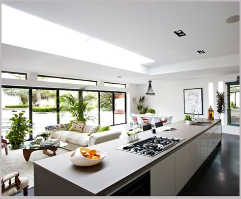 Lovely An abundance of natural light from landscaped lawned garden with terrace embraces the white open Poggenpohl kitchen fitted here with a five metre i u