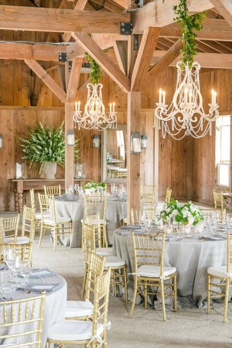 We absolutely love The Cotton Dock at Boone Hall. The rustic setting is perfect for our Gloster Chandeliers. Click to see more of our wedding portfolio for lighting inspiration✨ #RusticWedding #Chandelier #SouthCarolina #Charleston #RusticWeddingDecor #Reception #LightingIdeas #UniqueWeddingIdeas