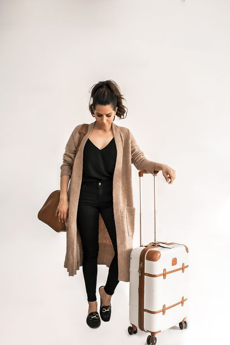 Black top+black skinny jeans+black loafers+camel long cardigan+cognac travel bag+white and cognac suit-case. Spring Travel Outfit 2018 outfit What to Wear on Your Next Flight - Olivia Jeanette