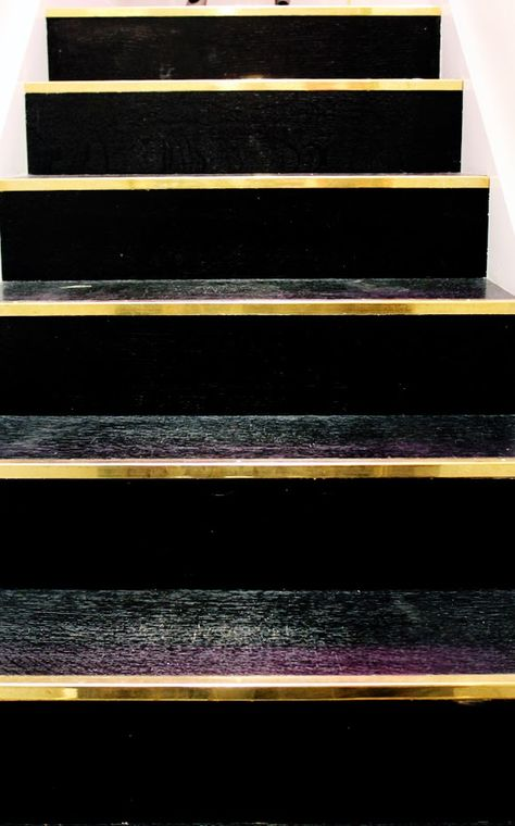black and brass stairs