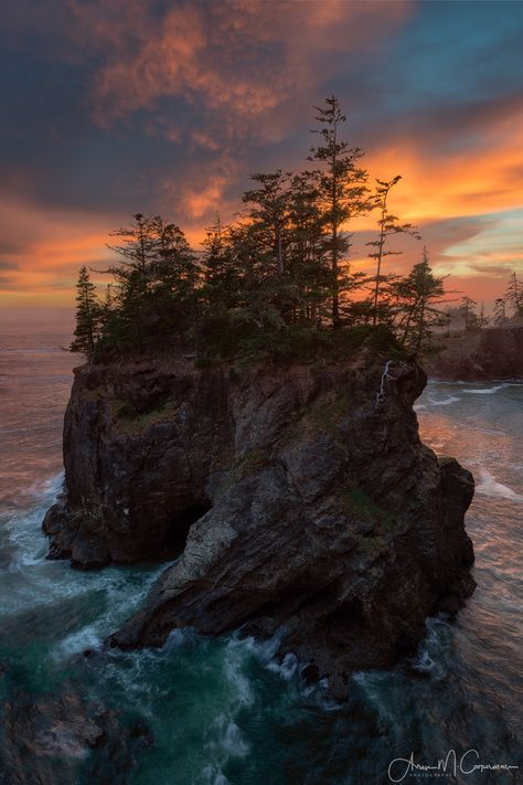 """Guardian of the Pacific - One of the largest sea stacks off the Southern Oregon coastline, this pillar of rock stands almost as a lookout to the changing waves of the Pacific Ocean as they crash into the coastline of Samuel H Boardman State Park. If you've never been here it is quite an adventure to find this location, there's a """"hidden"""" but not really much of a secret trail that friends and I """"found"""" when we shot here in May 2015. Feeling unsatisfied with the sunset of that night, I knew…"""