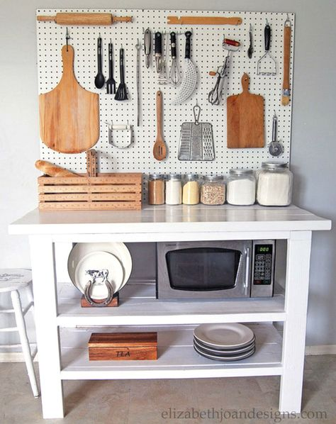7 Clever Ways to Add Kitchen Storage Without Layout Changes: Okay, this counter space with pegboard is genius for a small apartment space!