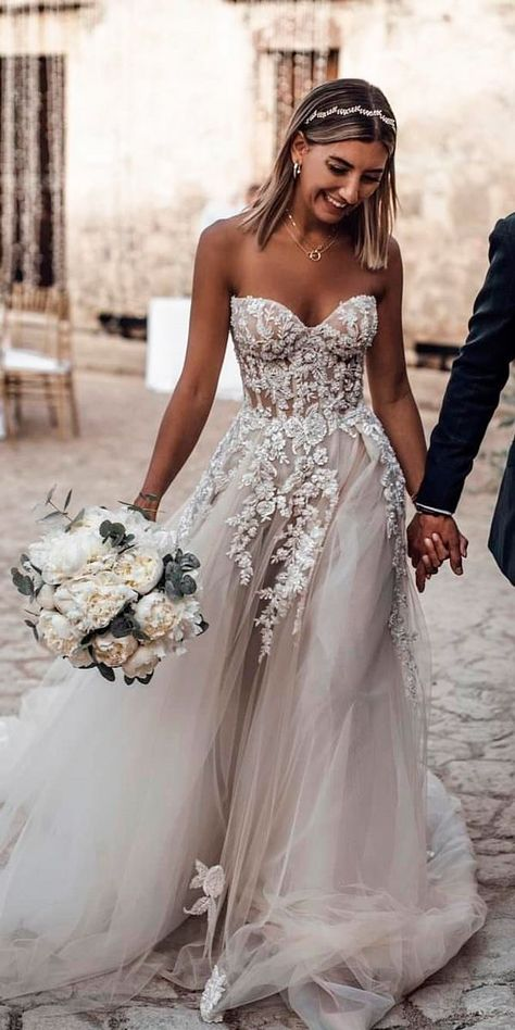 Gorgeous nude blush illusion strapless wedding gown. Lace ball gown dress sculpted bodice with tule skirt. Wedding gown inspiration.