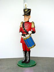 A large Life size nutcracker drummer tin soldier statue. This gorgeous beauty is part of a collection of hand crafted Christmas statues and collectibles. The incredible details depicted on this Christmas item truly makes it a piece of art. It is sure to attract crowd's attention and is a wonderful conversation piece. This large nutcracker statue is made from durable materials using cast resin mold mixed with fiberglass. It is hand painted to the highest detail by professional artisans. ...