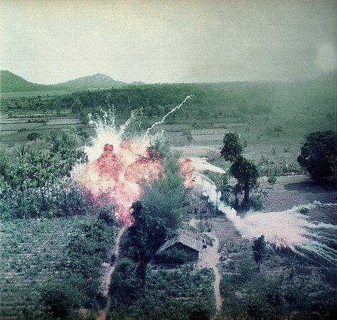 Vietnam War, Napalm bombs explode on Viet Cong structures south of Saigon in the Republic of Vietnam, circa late 1960s