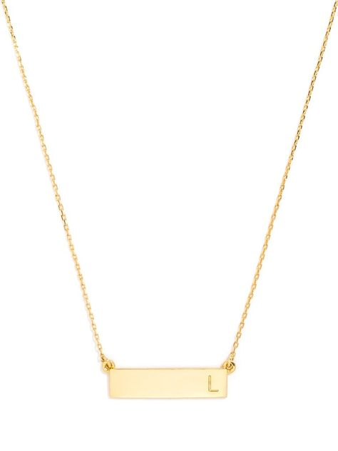 A thick bar engraved with a single block initial on one side is a sleek, modern personalized piece that layers well with more petite charms.