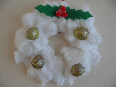 Cotton Wool Wreath – An Easy Christmas and Winter Craft - This wreath is decorated with halves of walnuts that have been painted with golden paint.