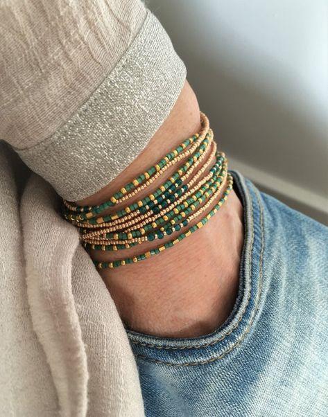 Set of two Boho bracelets, necklace, seed beads bracelet, wrap bracelet Beautiful set of two boho wrap bracelets, lots of 24 kt gold plated 2 cut seed beads give this bracelet a beautiful sparkle. Seed Bead Bracelets, Seed Bead Jewelry, Beaded Jewelry, Handmade Jewelry, Seed Beads, Wrap Bracelets, Gold Bracelets, Emerald Jewelry, Ankle Bracelets
