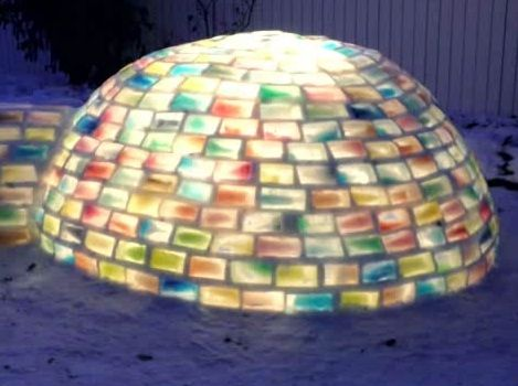 The multi-coloured igloo took 100 hours over two months to complete.