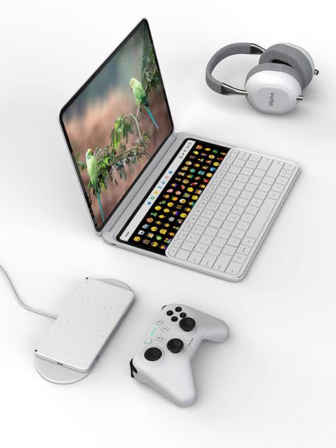 A dual screen multi-touch laptop with a sliding keyboard that reveals a track pad below it or a secondary display for the dock and other secondary functions above it. The design also features a large wireless charging pad.