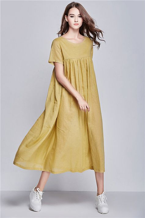 yellow linen dress for women.  【Characteristic】 Extravagant flattering loose dress , so elegant and comfy ... Perfect solution for your everyday outfit:) ...not only... This would be  turn around  garment wherever you go! Your fashion update , your home entertainment your casual style ,your beach cover up, your party inspiration and so...so ...on:)  【Details】 1. asymmetrical skirt styling, flattering look 2. short sleeves with border detail 3. little pleats over the top. 4. two pockets 5…