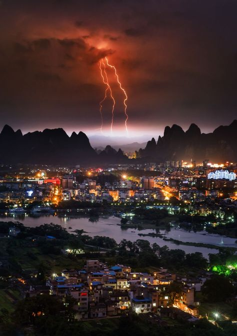 Here's a photo I recently finished from the Guangxi province of China. It wasn't the easiest shot to get as I had to climb up one of those big hills you see in the distance. I was a hot sweaty mess when I got to the top... but just after I took the photo, a spring rain came down on me to cool me off. #TreyRatcliff #China #Lightning #Landscape #Storm #China #HDR