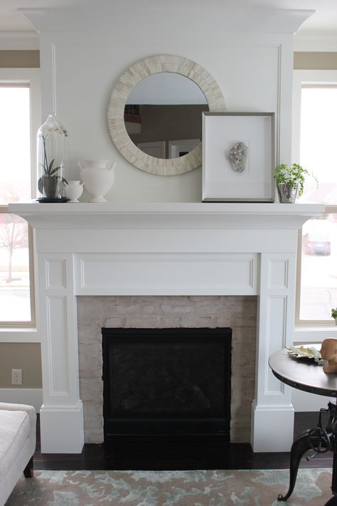 interiors by alice lane home collection | white fireplace, white pots, white orchid, round shell mirror, crystal artwork, maidenhair fern