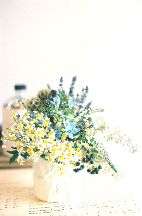 A Blue And Yellow Feverfew And Tweedia Centerpiece Brides Com Blue Brides Bridescom Centerpiece Feverfew Tweedia Yellow Flower Arrangements Wedding Reception Decorations Silk Flower Arrangements