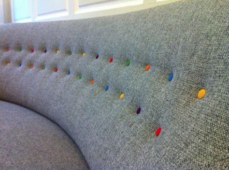 #decoratecolorfully colorful buttons on the couch in the kate spade pop up shop in london