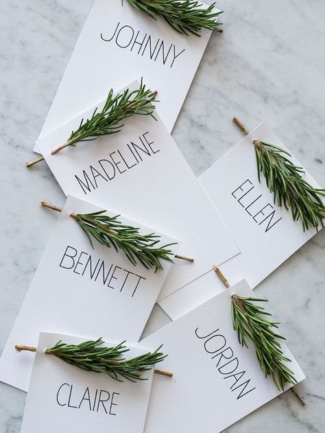 Christmas Table Placecards: Each one is decorated with Rosemary (could also use a pine sprig accent)