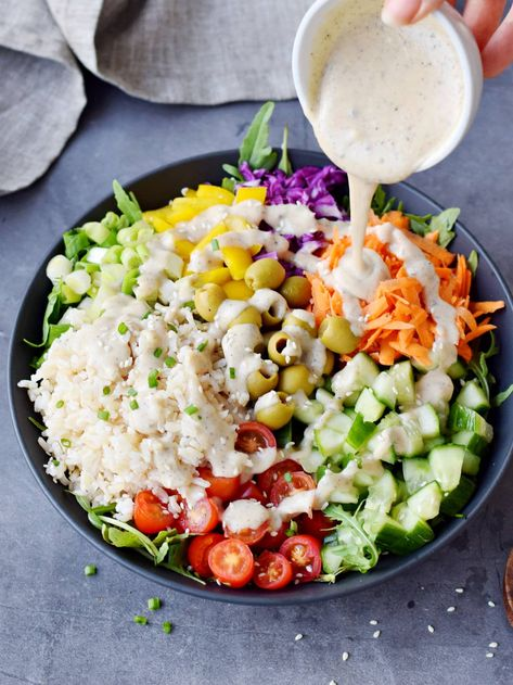This vegetable and rice salad is a hearty, healthy, and nutritious summer salad, or side dish. Combining brown rice, vegetables, and a vegan sour cream-based dressing- this recipe is gluten-free, dairy-free, vegan, and super satisfying! #ricesalad #vegansalad #veganbuddhabowl #summersalad #elasrecipes | elavegan.com