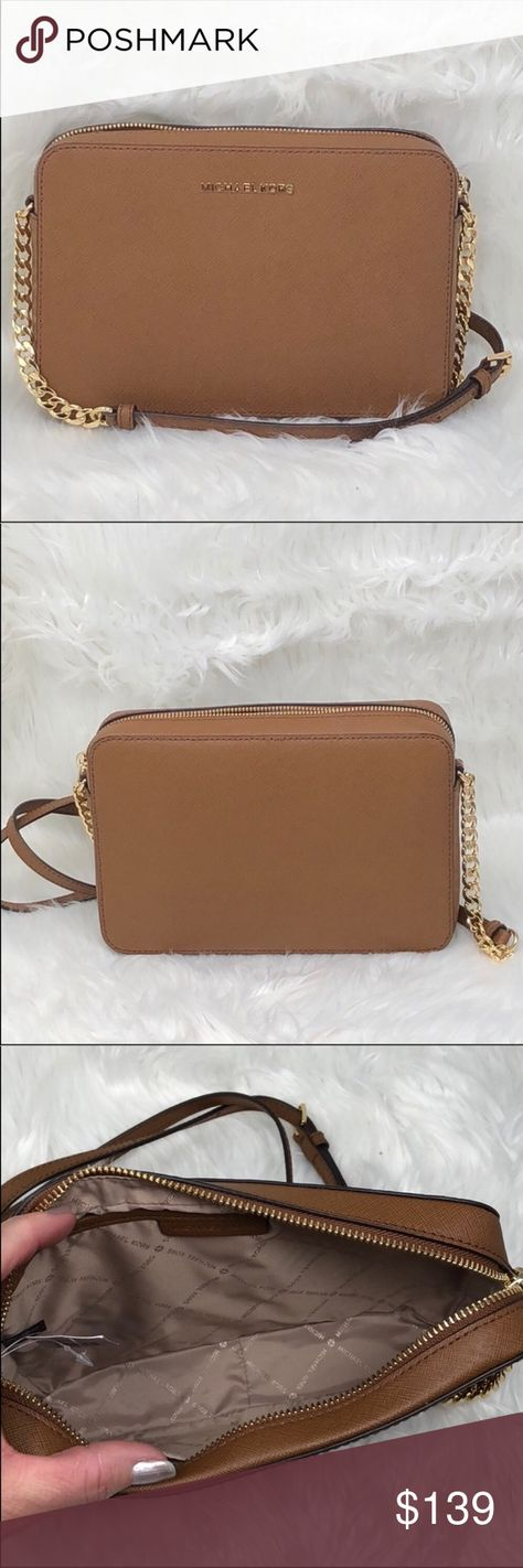 15ac3807b64d Nwt Michael Kors Jet Set item crossbody luggage Structured in a clean-lined  silhouette crafted