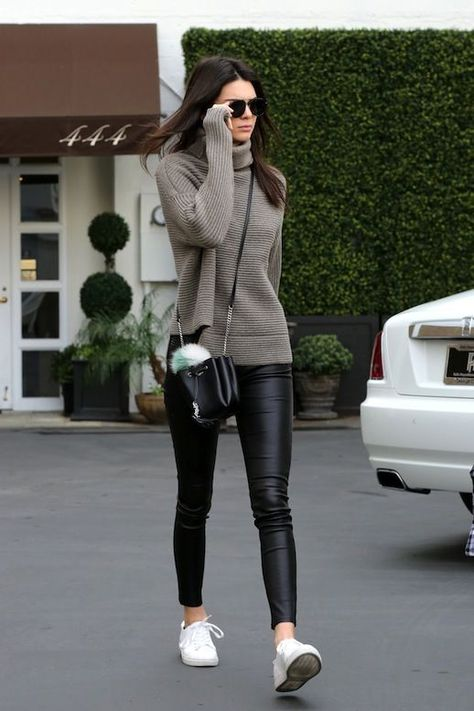 Photos via: Kendall-Jenner.Net Kendall Jenner's street style rivals the supermodels of yesteryear. Her ribbed asymmetrical turtleneck sweater, cropped leather pants and white sneakers come together to