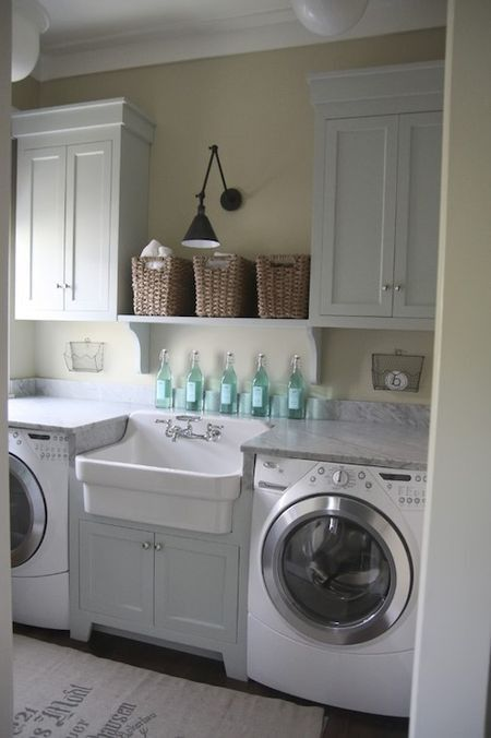 LOVE this laundry room. Big sink - great for dirty work. Counter on top of washer/dryer to fold. Storage above. Now just need somewhere to hang drying clothes.