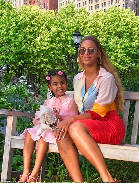 Mommy and me! Beyoncé showed off a smile as she posed with four-year-old daughter Blue Ivy and their dog while enjoying some downtime at the park