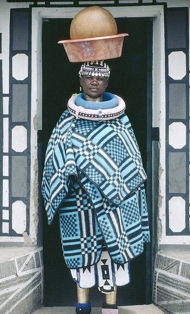 Ndebele woman carrying beer in a traditional beer clay vessels, circa 1983 in Limpopo Rural, Limpopo, South Africa.