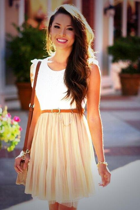 basic summer date outfit: dress with twirled waved  hair and gold bracelet with a brown purse