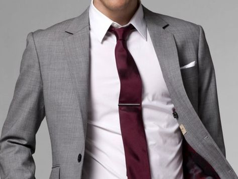 Grey jacket and red tie