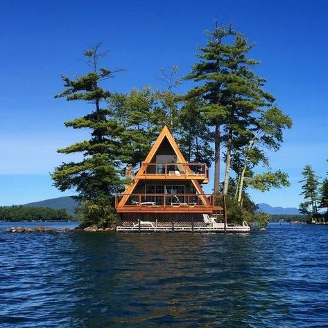 A-frame cabin on a tiny island in a mountain lake. P.S. We'd love to know who took this photo; we're repinning from a pin that didn't have any credit or URL - let us know in the comments with an original URL so we can get credit back on this photo and get it circulating with rightful credit again!#MakePinterestGreatAgain;)