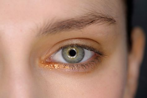 "Autumn/Winter 2014: Molten Metallics --- Issey Miyake ""The spirit of the forest"" was make-up artist Alex Box's inspiration at Issey Miyake, where she used MAC's Fluidline liquid liner in Copperthorn at the inner corners of the eyes."