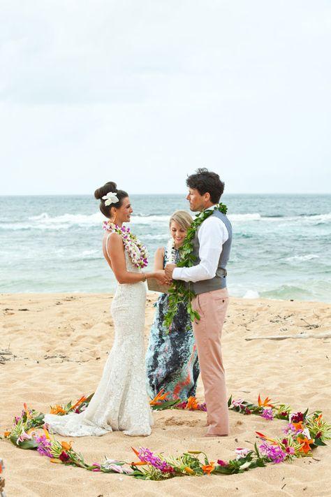 Hawaiian wedding ceremony complete with leis exchange & traditions | Technicolor Tropical Destination Wedding In Wainiha Bay Kauai Hawaii | Photograph by Martina Micko   http://storyboardwedding.com/technicolor-tropical-destination-wedding-wainiha-bay-kauai-hawaii/