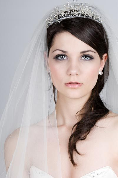 hairstylestars:    Wedding Hairstyle with Veil and Tiara  Your wedding day is your time to shine. Make the most of your special day by wearing a wedding veil and a tiara! Check out these bridal hairstyle pictures for hairstyles that work with both a wedding veil and crown.