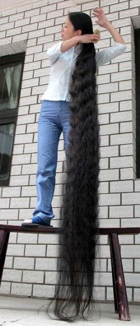 No way do I want crazy long hair like this, but I would like it a little longer to have more options for my hair..this site gives tips on how to grow your hair fast.